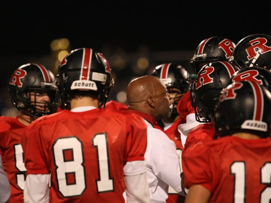 Rossview coach Ron Lambert tries to inspire his team