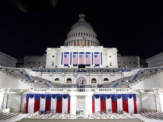 The U.S. Capitol is seen lit up early on the morning
