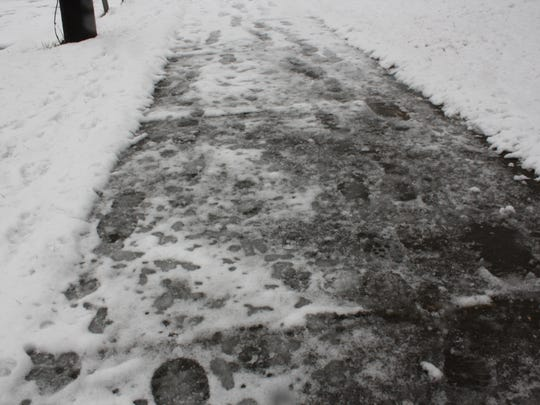 The sidewalk of Campbell road in Binghamton was covered in snow and ice Tuesday morning.