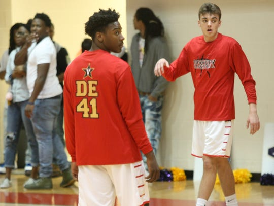 Rossview High basketball players warm up before a game