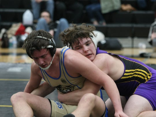 Clarksville High's Bradley Williams gains control of his 182-pound region championship match against Niko Noga of Mt. Juliet Saturday at Mt. Juliet High School. Williams captured the region title.