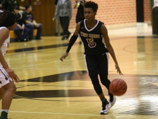 West Creek's Diamond Jones (5) looks for space to operate