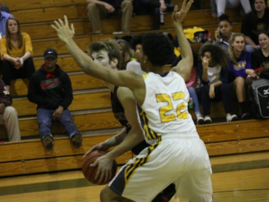 A Rossview player attempts to look for his shot against