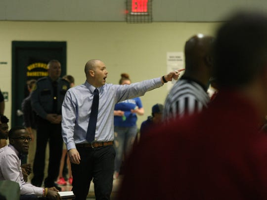 Northeast boys coach John Stigall shouts instructions