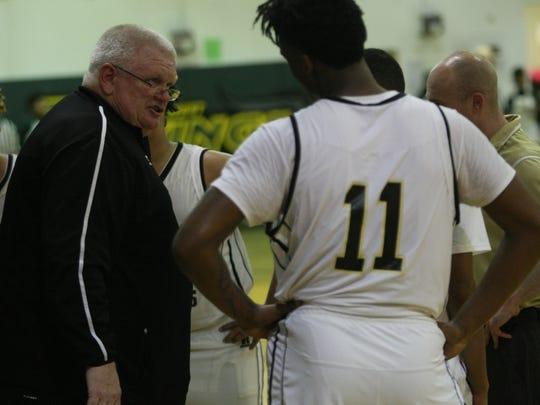 Springfield coach Darryl Travis talks to his team during
