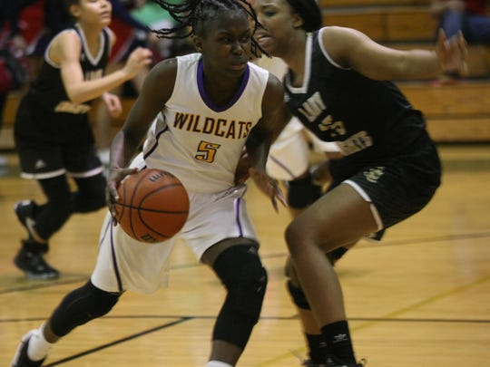 Clarksville High's Deja Walls (5) leads the Lady Wildcats
