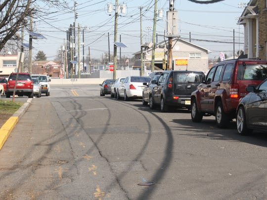 A line of parked cars at Money and John streets stretches to the Route 46 entrance. Some residents of the area were not happy that their streets were not included in the ordinance.