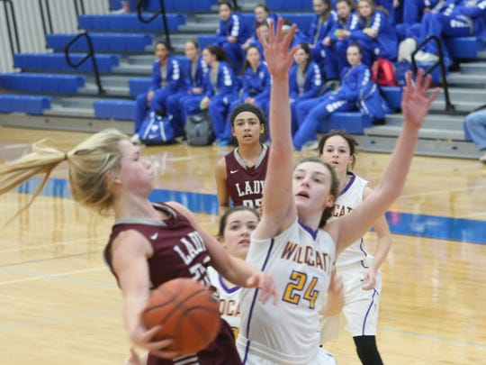 Clarksville's Lainey Persinger defends on a Station