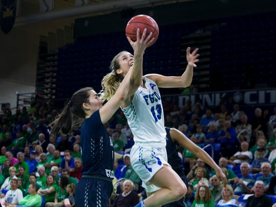 Florida Gulf Coast University senior, Jordin Alexander, #13, goes for a layup during the ASUN quarterfinal game against the University of North Florida on Friday, March 3, 2017 at Alico Arena in Estero.