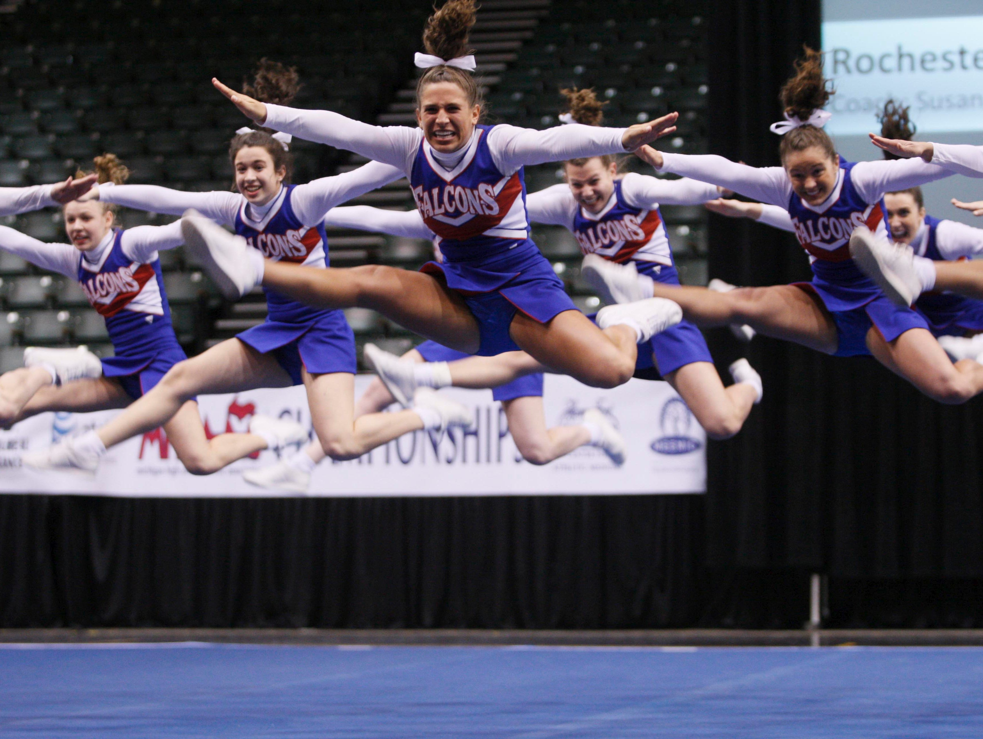 Girls in the Rochester competitive cheer team compete in the state finals at the Delta Plex in Grand Rapids on March 7, 2008.