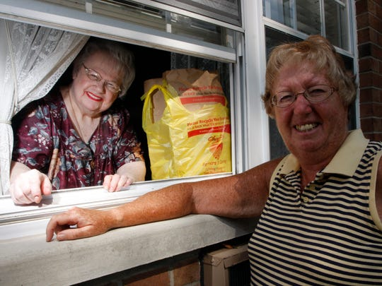Mary Hafele purchased and delivered groceries to Della Conti for a decade. The Little Falls residents are shown here in 2008 for a delivery through Conti's rear window.