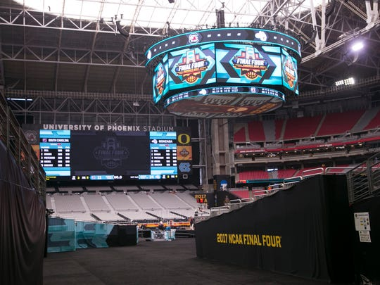 The scoreboard above the Final Four court at University of Phoenix Stadium in Glendale on Thursday, March 30, 2017.