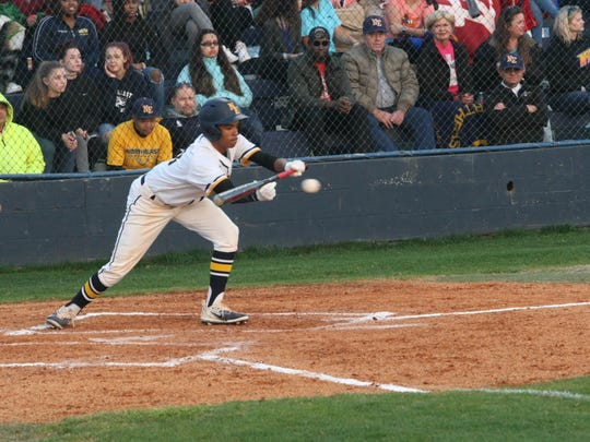 Northeast tries to lay down a bunt in the first inning