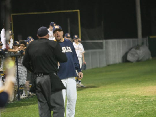 Northeast baseball coach Dustin Smith talks to the umpire between innings during a District 10 baseball game against Springfield earlier this week.