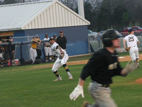 Northeast's Chris Barnes sets to throw out a Springfield