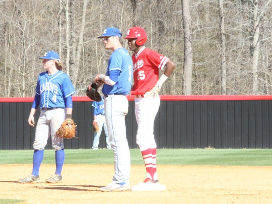 Rossview's Elijah Pleasants (25) talks with a Karns player at first base during the second inning of their William Workman Invitational game April 7, 2017 in Clarksville.