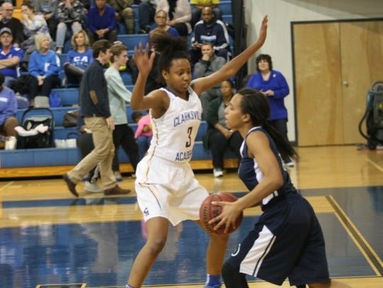 Clarksville Academy's Sydneey Boykin (3) guards a player