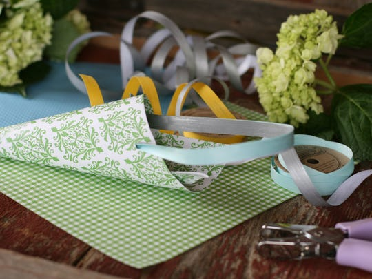 Simple cone-shaped May baskets can be fashioned from wallpaper samples or card stock and ribbon.