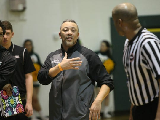 Northwest coach Vincent Turner talks with an official during a game earlier this year. Turner was named All Area Coach of the Year after guiding his team to its first district tournament championship in 22 years.