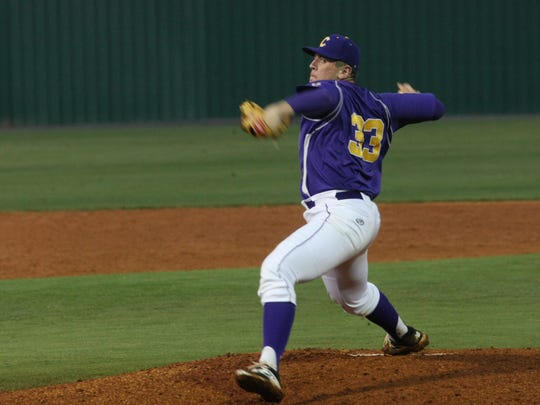 Clarksville's Cody Spurgeon delivers a pitch to home
