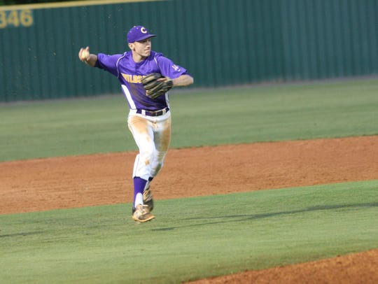 Clarksville's Luke Chilcutt throws the ball to first