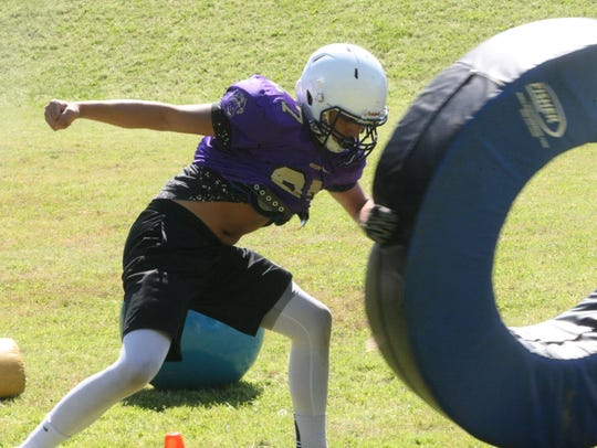 Clarksville High goes through drills during the spring