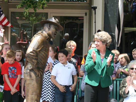 The statue of Sgt. Carter stares down Clarksville Mayor