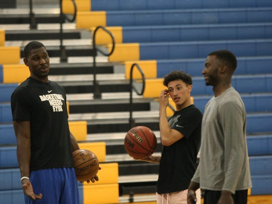 Alex Poythress (left) talks with former Clarksville