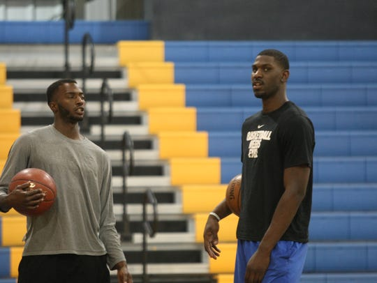 Alex Poythress (right) talks with former Kenwood star