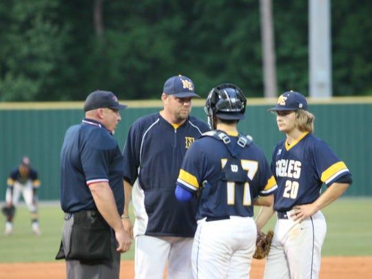 Northeast coach Dustin Smith talks to pitcher Collin