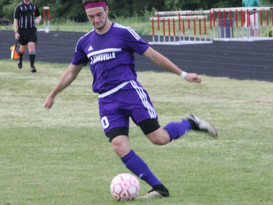 Clarksville's David Jones kicks the ball toward a teammate