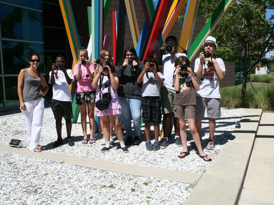 Digital Photography students can't put their cameras down at the Elliott Museum's Summer Art Camp program taught by Livia DeBonet, left.