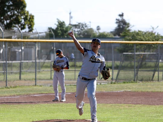 Alvarez's Ivan Rocha throws to first base in the early innings of the Eagles' game at Alisal.