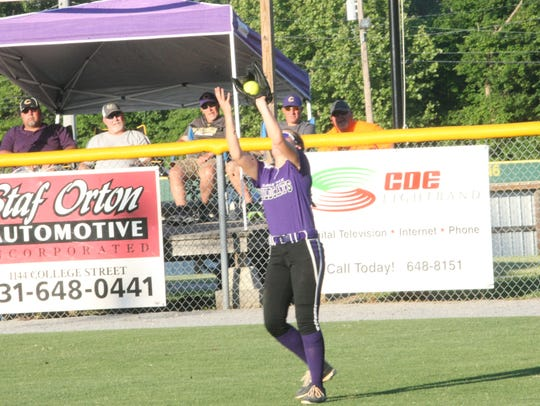 Clarksville center fielder Madison Berner gathers in