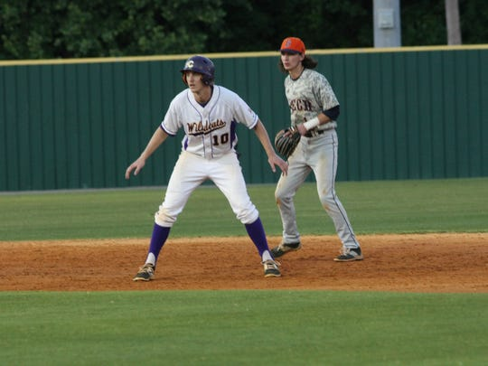 Clarksville High's Teal Young (10) steps off the second