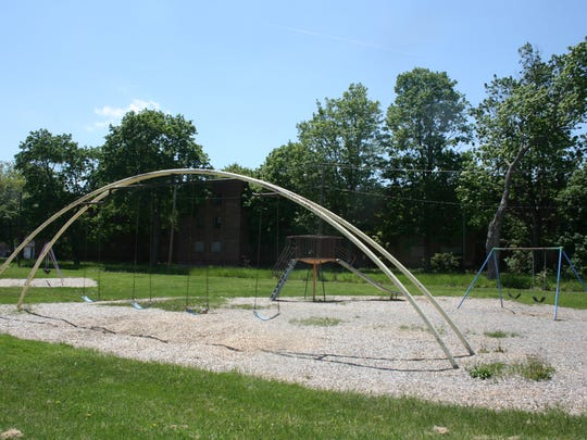 A proposed redesign of Ernie Davis Park in Elmira would replace aging playground equipment with a low-profile play area made of natural materials.