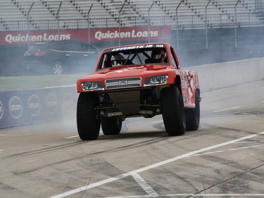 Arie Luyendyk Jr. burns rubber driving down pit lane in his SPEED Stadium Super Truck at Belle Isle on May 19, 2017.