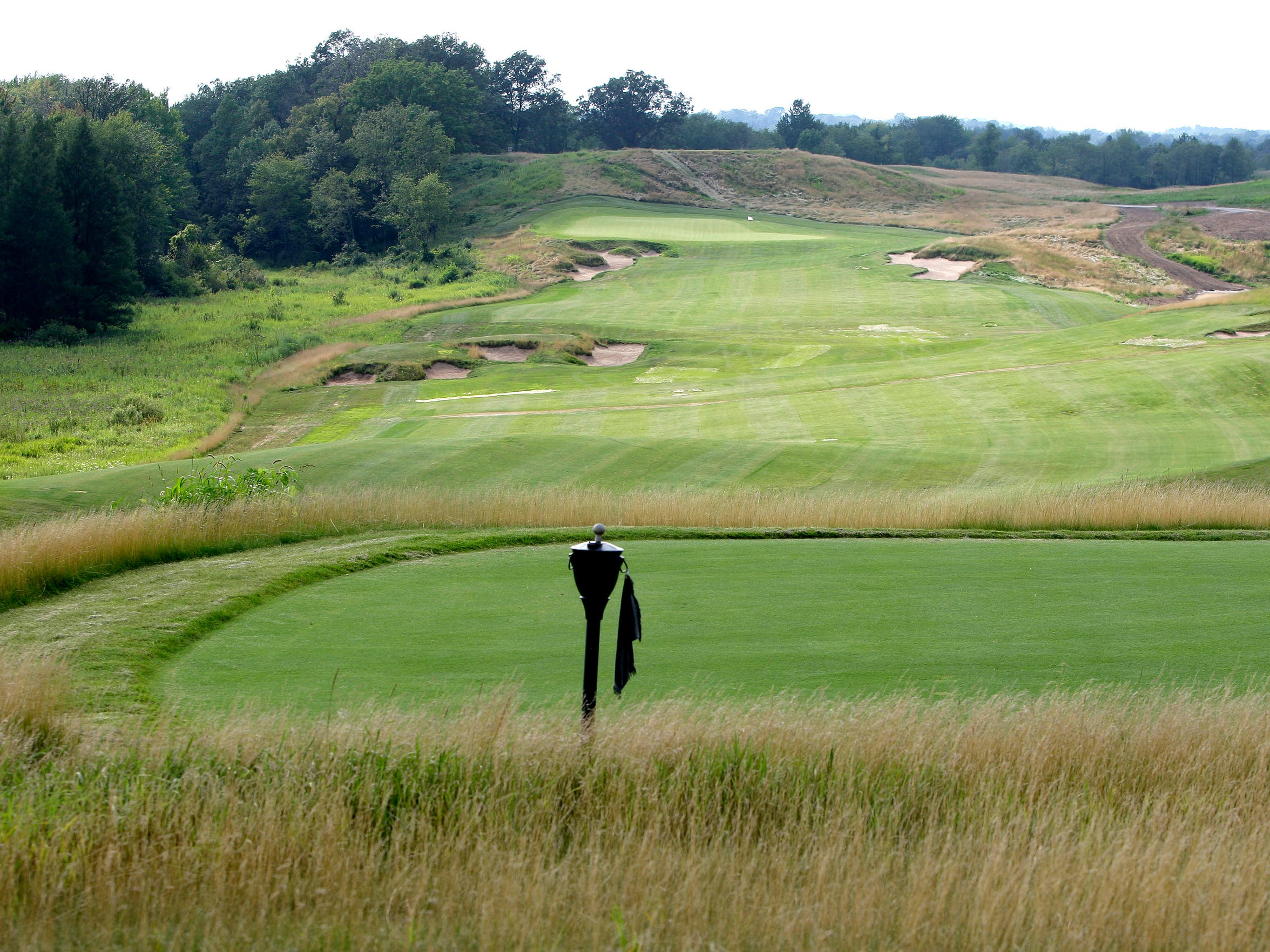 When Erin Hills reopened in the summer of 2010 after Andy Ziegler had taken over, it had become a walking-only golf course, in part to help the struggling fescue fairways have a chance to fill in and mature. This photo was taken in July 2010 from the tee box of the par-4 third hole.