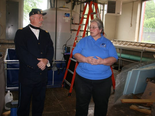 Douglas Oakes and Terri Olszowy of Friends of the Elmira Civil War Prison Camp discuss an upcoming event scheduled for June 24-25 during an announcement in Elmira.