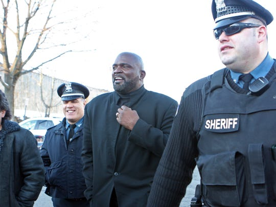 New York Giants legend Lawrence Taylor leaving Rockland's courthouse after pleading guilty to sexual misconduct and patronizing a prostitute in January 2011.