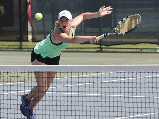 Iowa City West's Emma Koch and her sister Audrey reached the Class 2A state semifinals with two convincing wins Wednesday.