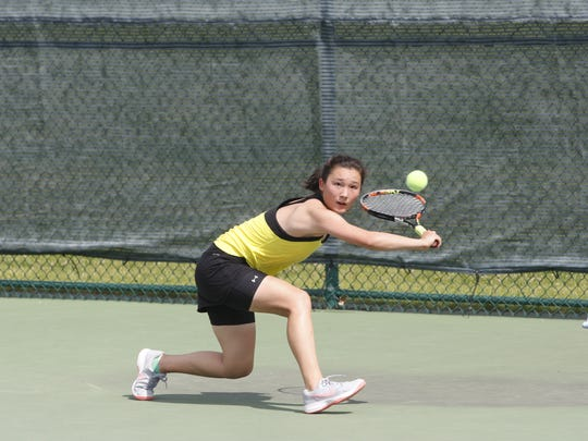 Bettendorf's Emilia Porubcin reaches for the ball during her semifinal match against Boone's Davi Patterson in the girls' Class 2A state singles tournament.