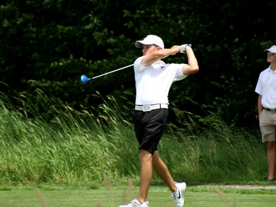 Zach Rosendale of St. Johns, tees off on the final