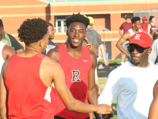 Rossview High's boys track team gathers in the infield
