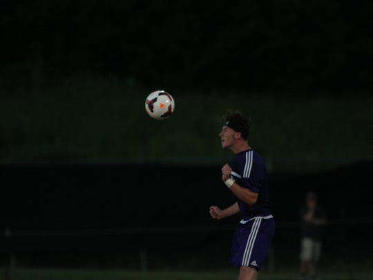 Clarksville's Ryan Gasaway heads the ball back toward