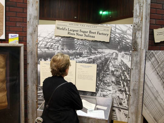 "A visitor examines artifacts at the ""Made in Spreckels"""