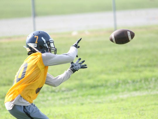 A Northeast player prepares to catch the ball during