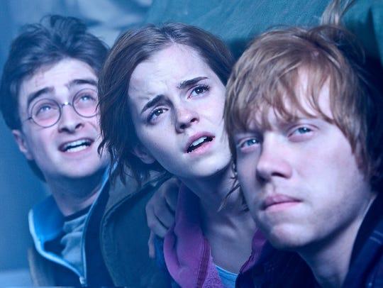 DANIEL RADCLIFFE as Harry Potter, EMMA WATSON as Hermione