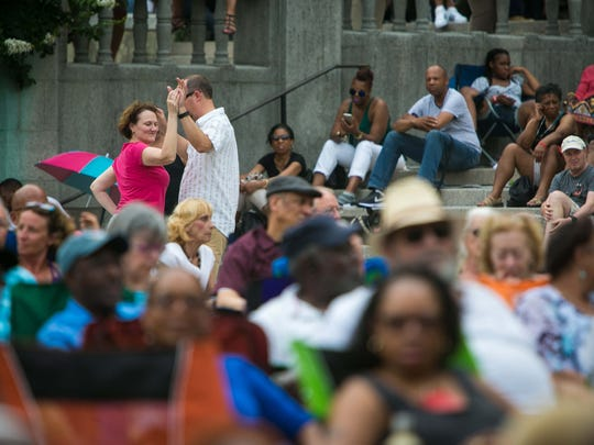 A couple dances in the crowd as Karen Rodriguez performs at Rodney Square Thursday for the 2017 Clifford Brown Jazz Festival.