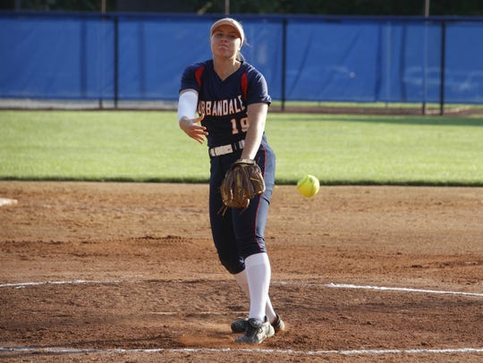 Urbandale's Bella Crow throws a pitch during the J-Hawks'